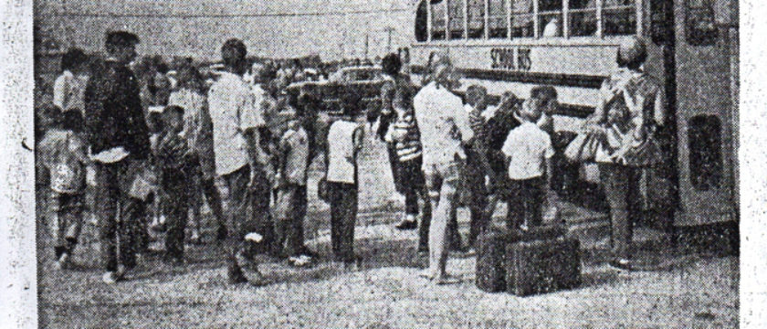 Picture from news article of students boarding bus for HEB Camp
