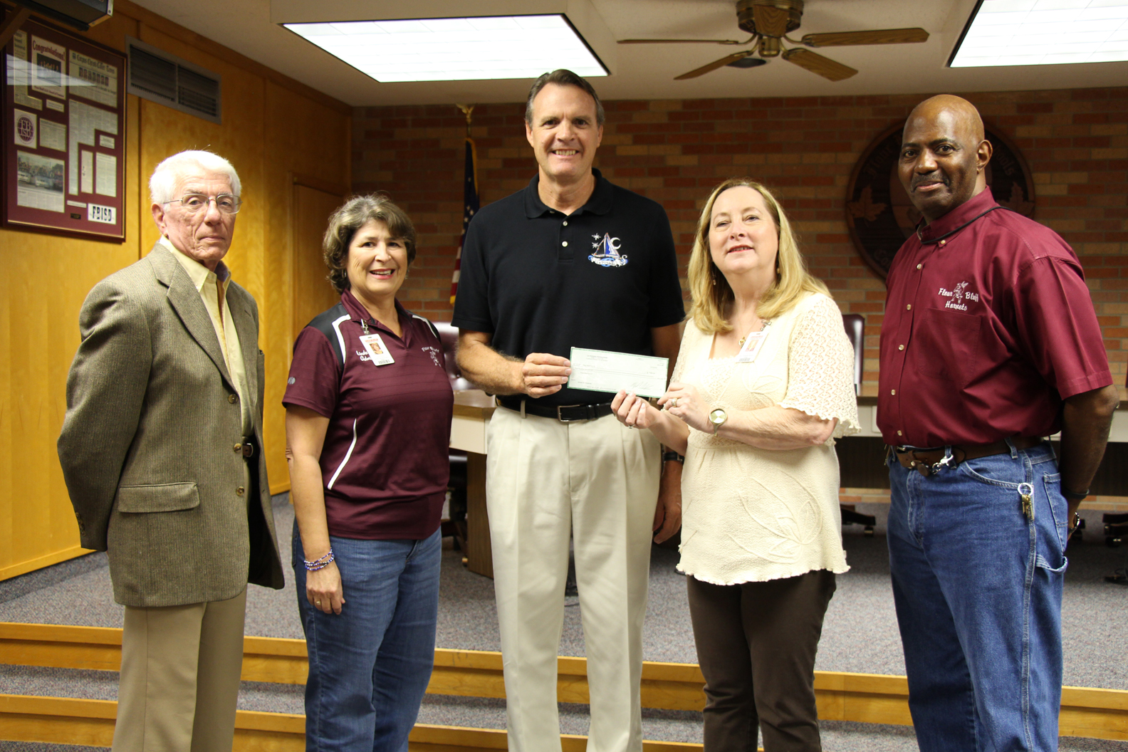 Members of the La Posada Foundation present District Administrators with a $500 check