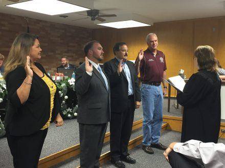 Img file Picture of new and reflected board members being sworn in.