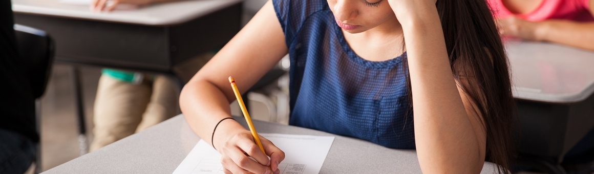Image of student taking a test in a classroom