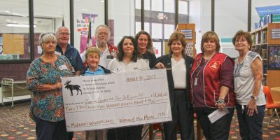 image check donation from Moose Lodge for students to attend Morgan's Wonderland