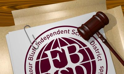 FBISDs logo with gavel laying on the podium