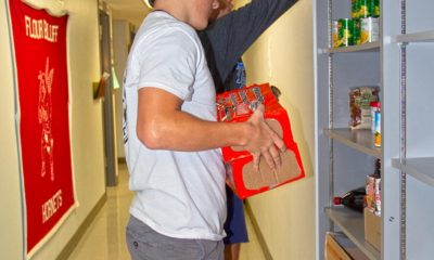 CPittman TNelson stock food on the shelves of the KeyClub Pantry