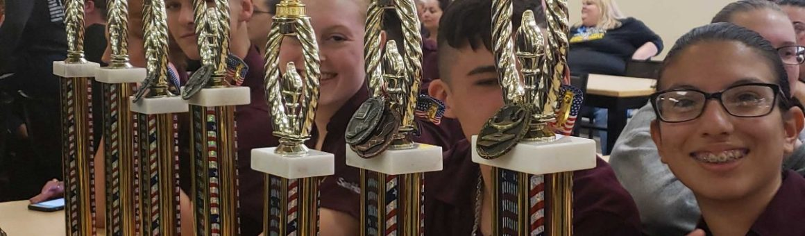 image FBHS NJROTC cadets with trophys