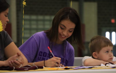 student accepting her college of choice on signing day