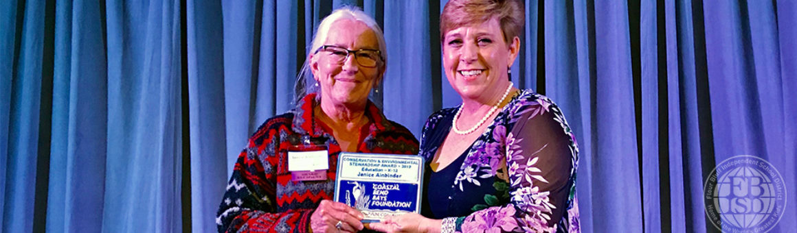 Janice accepting an award picture