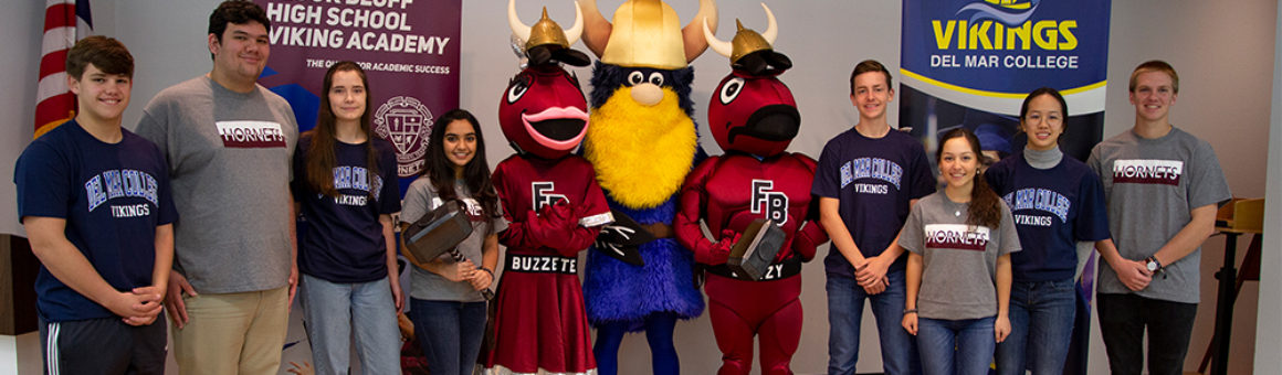 FBHS and DMC mascots with FBHS dual credit students during Viking Academy official announcement