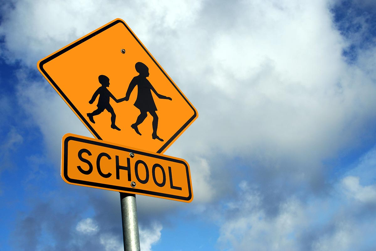 image of yellow school crossing sign