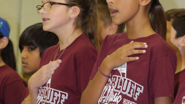 picture of Intermediate students singing during Veterans Day Ceremony