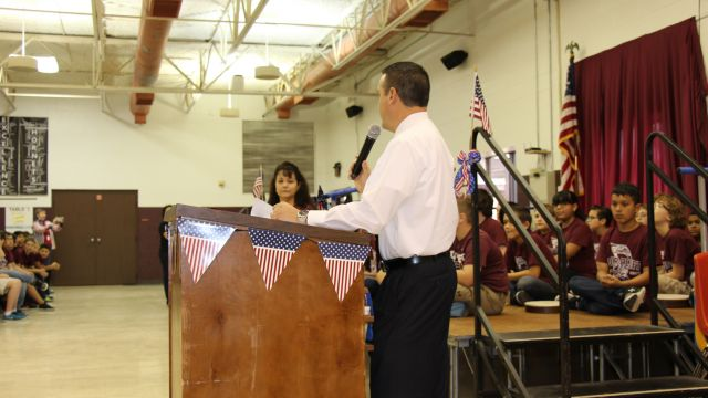 Picture of Dr. Alvarado addressing audience at Intermediate Veterans Day Ceremony
