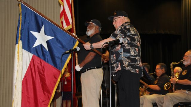 Picture of Veterans from Corpus Christi Veterans Band holding flags during Primary's Veterans Day Ceremony