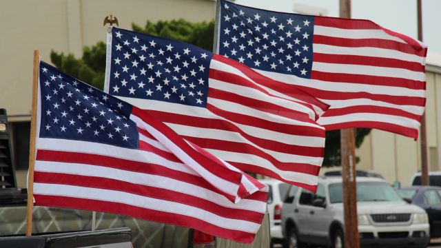 picture of American Flags being flown around the District