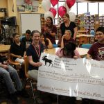 image of students with check image check donation from Moose Lodge for students to attend Morgan's Wonderland