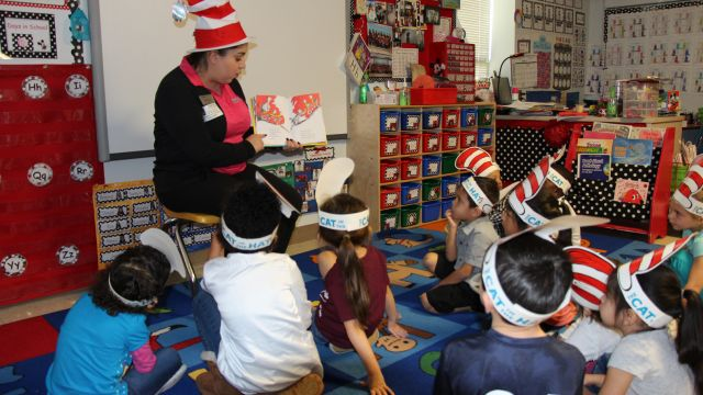 age Navy Army Credit Union representative reads to students at the ECC in celebration of Dr Seuss Day