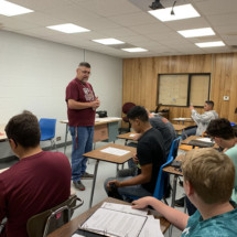 Construction Class Instructor, Mr. Taylor, provides classroom instruction during the Principals of Construction class